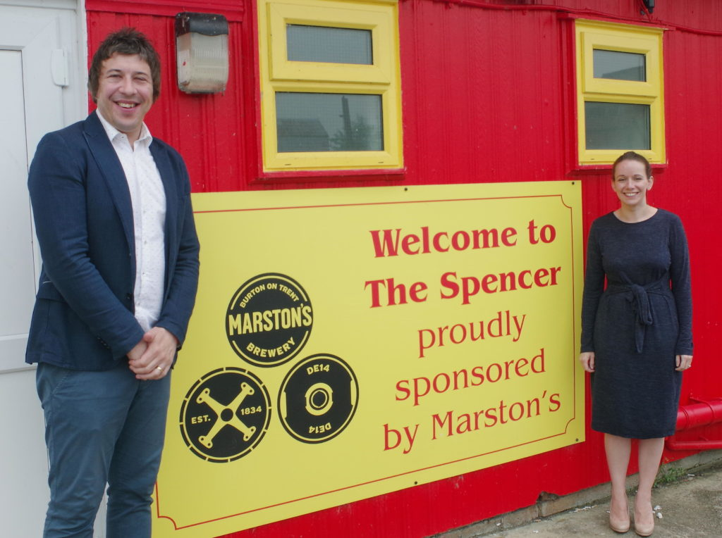 Banbury United Commercial Director Mark Allitt with Marston's Business Development Manager for the South Midlands Charlotte Robertson